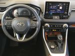 Gray[Lunar Rock/Ice Edge Roof] 2021 Toyota RAV4 Steering Wheel and Dash Photo in Kelowna BC