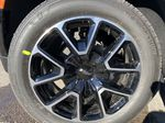 Black[Black] 2021 Chevrolet Suburban RST Left Front Rim and Tire Photo in Calgary AB