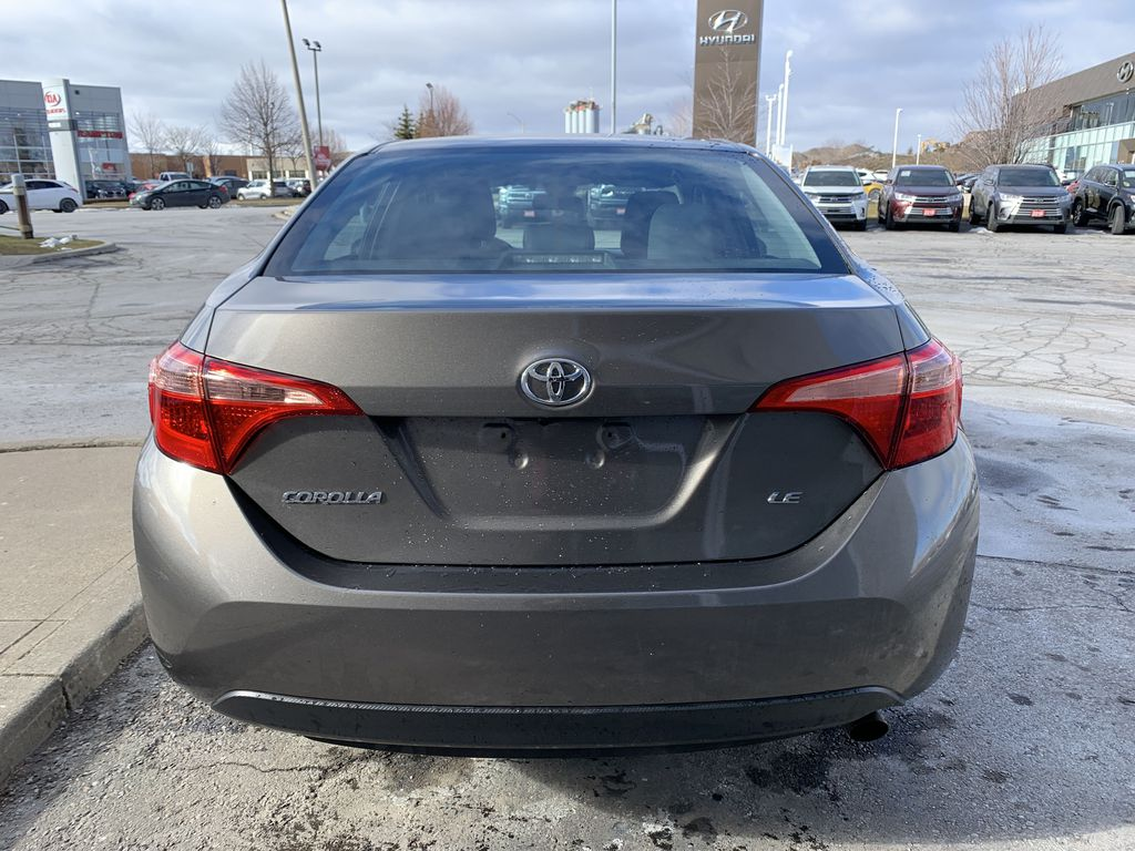 Brown 2018 Toyota Corolla Left Front Interior Photo in Brampton ON