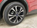 Red[Rapid Red Metallic Tinted Clearcoat] 2021 Ford Escape Left Front Rim and Tire Photo in Dartmouth NS