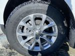 White[Summit White] 2021 Chevrolet Equinox LT Left Front Rim and Tire Photo in Calgary AB