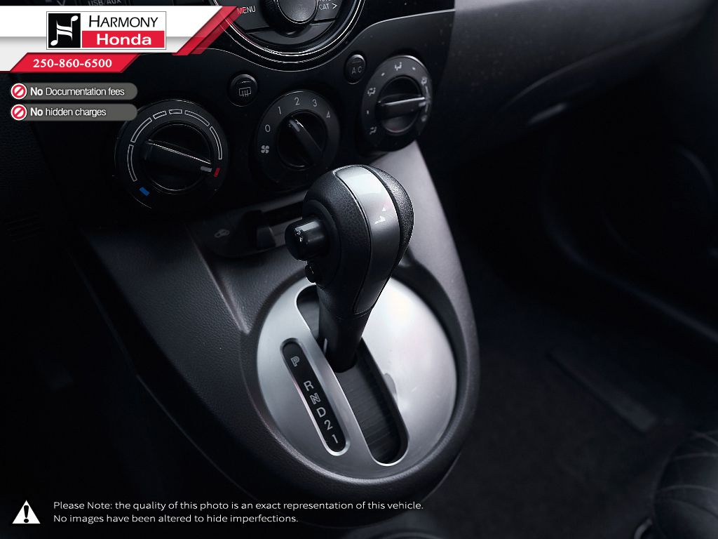 White - Crystal White Pearl 2014 Mazda Mazda2 Left Driver Controlled Options Photo in Kelowna BC