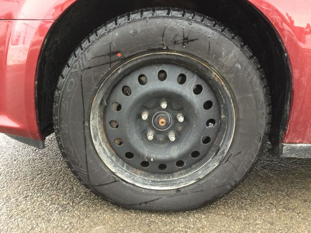 Red[Deep Cherry Red Crystal Pearl] 2016 Dodge Grand Caravan Left Front Rim and Tire Photo in Brockville ON