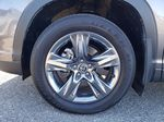 Silver[Celestial Silver Metallic] 2018 Toyota Highlander Left Front Rim and Tire Photo in Kelowna BC