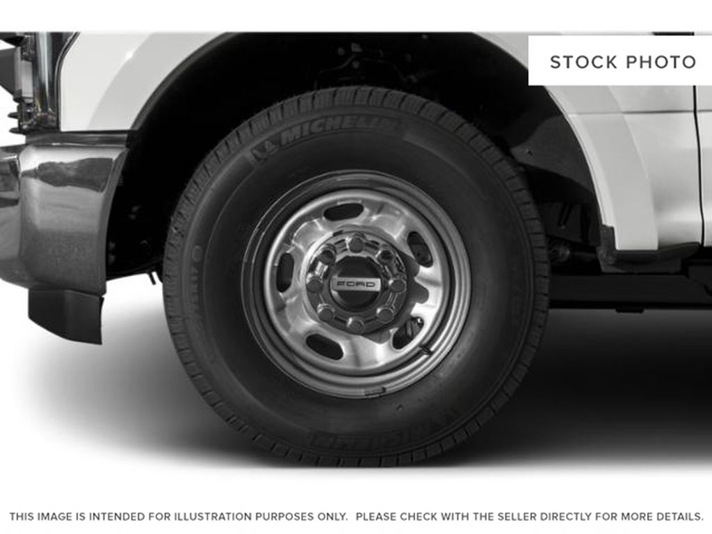 White[Oxford White] 2019 Ford Super Duty F-350 SRW Left Front Rim and Tire Photo in Fort Macleod AB