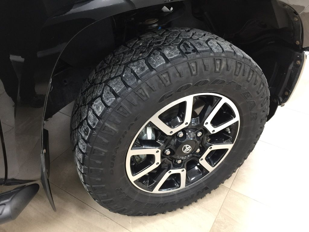 Black[Midnight Black Metallic] 2018 Toyota Tundra TRD Off-Road Double Cab 4WD Right Front Rim and Tire Photo in Sherwood Park AB