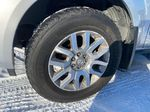 Silver[Airstream Metallic] 2012 Nissan Pathfinder Left Front Rim and Tire Photo in Lethbridge AB