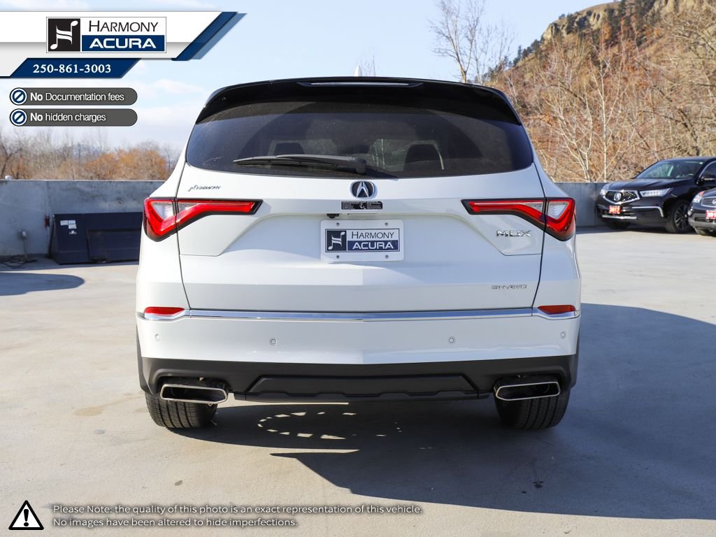 WHITE NH-883P 2022 Acura MDX Left Side Photo in Kelowna BC