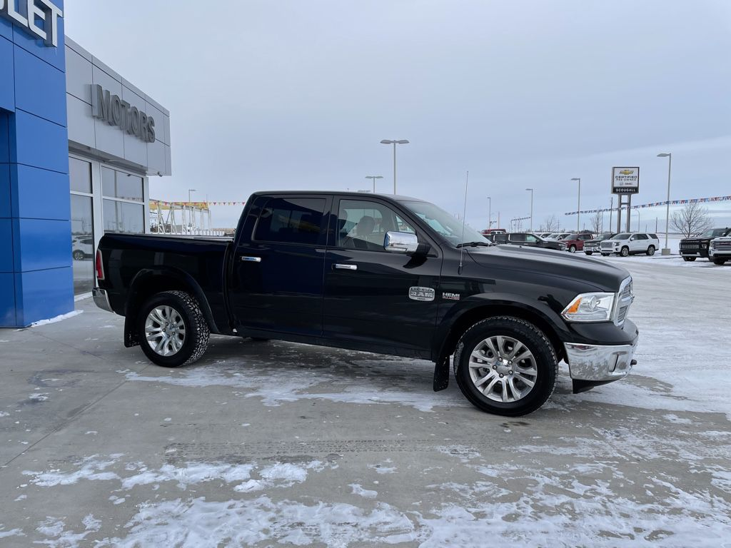 Black[Brilliant Black Crystal Pearl] 2017 Ram 1500 Left Front Rim and Tire Photo in Fort Macleod AB