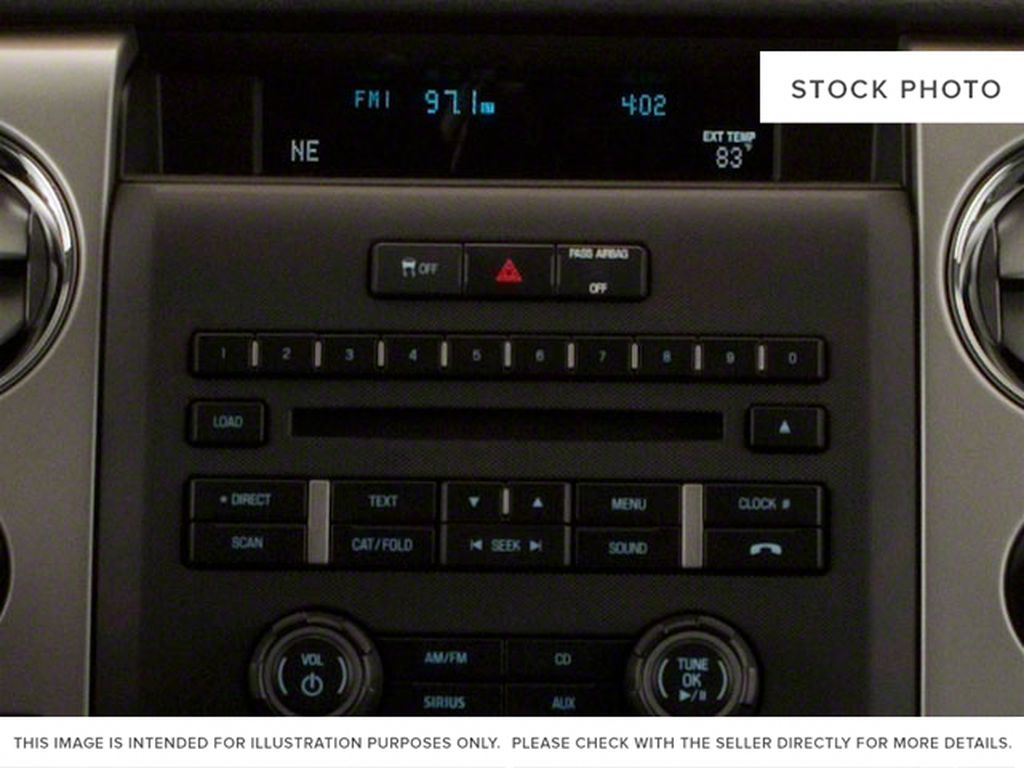 Red 2011 Ford F-150 Radio Controls Closeup Photo in Fort Macleod AB