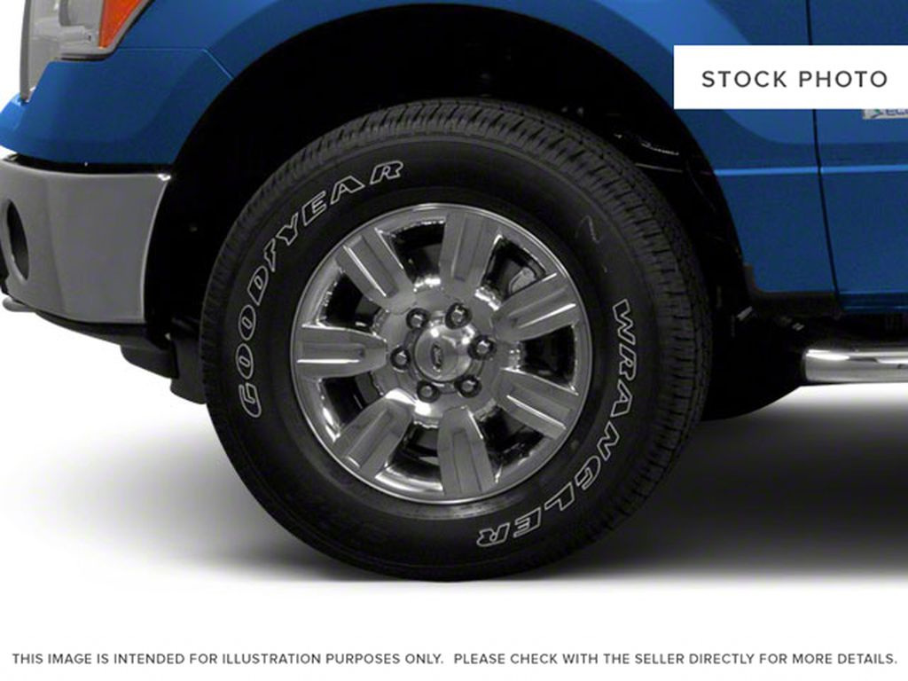 Red 2011 Ford F-150 Left Front Rim and Tire Photo in Fort Macleod AB