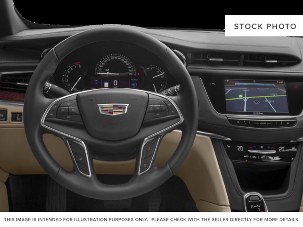 White[Crystal White Tricoat] 2017 Cadillac XT5 Steering Wheel and Dash Photo in Fort Macleod AB