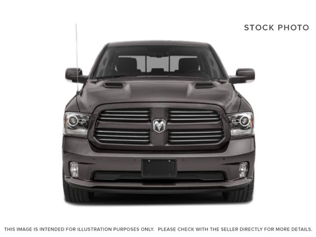 Red[Flame Red] 2018 Ram 1500 Front Vehicle Photo in Fort Macleod AB