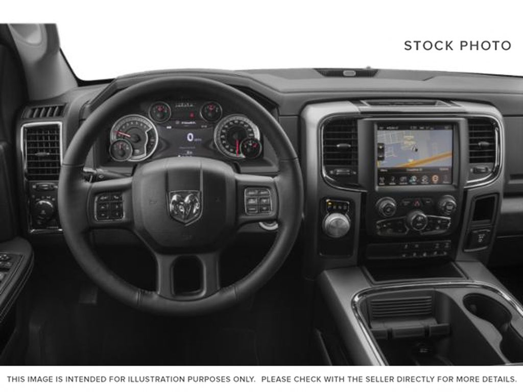 Red[Flame Red] 2018 Ram 1500 Steering Wheel and Dash Photo in Fort Macleod AB