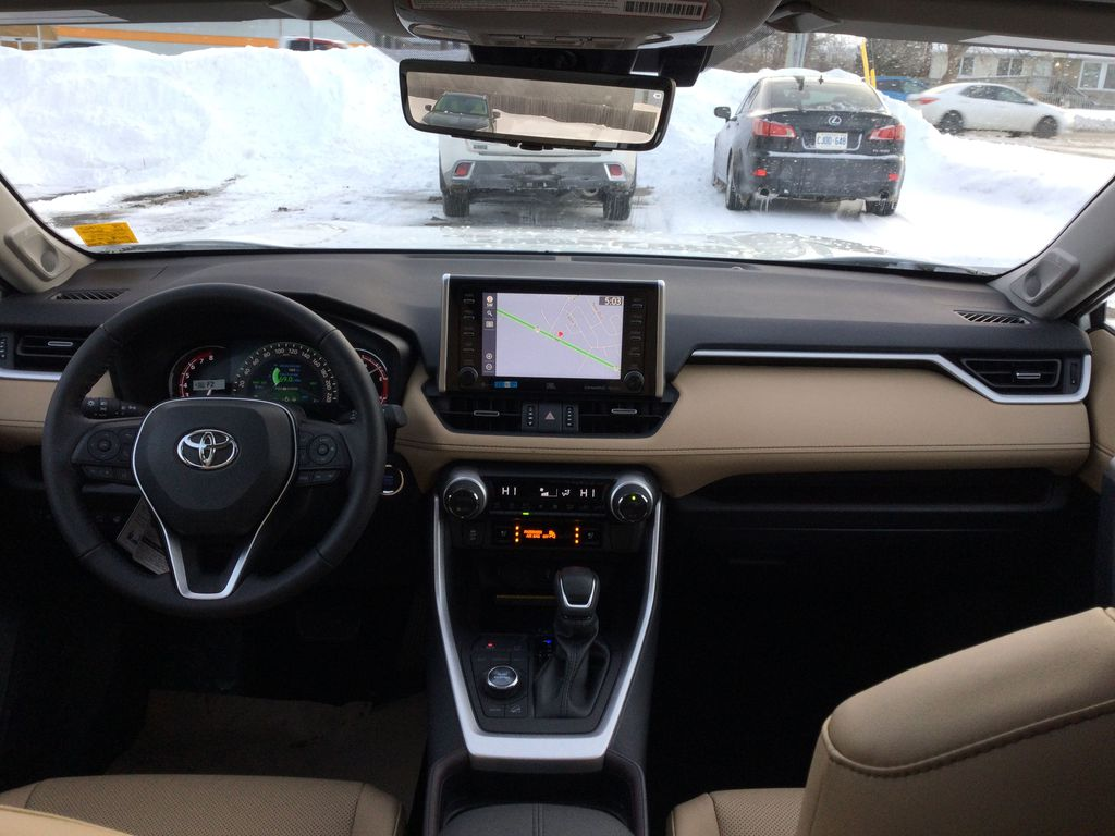 White[Blizzard Pearl] 2021 Toyota RAV4 Strng Wheel/Dash Photo: Frm Rear in Brockville ON