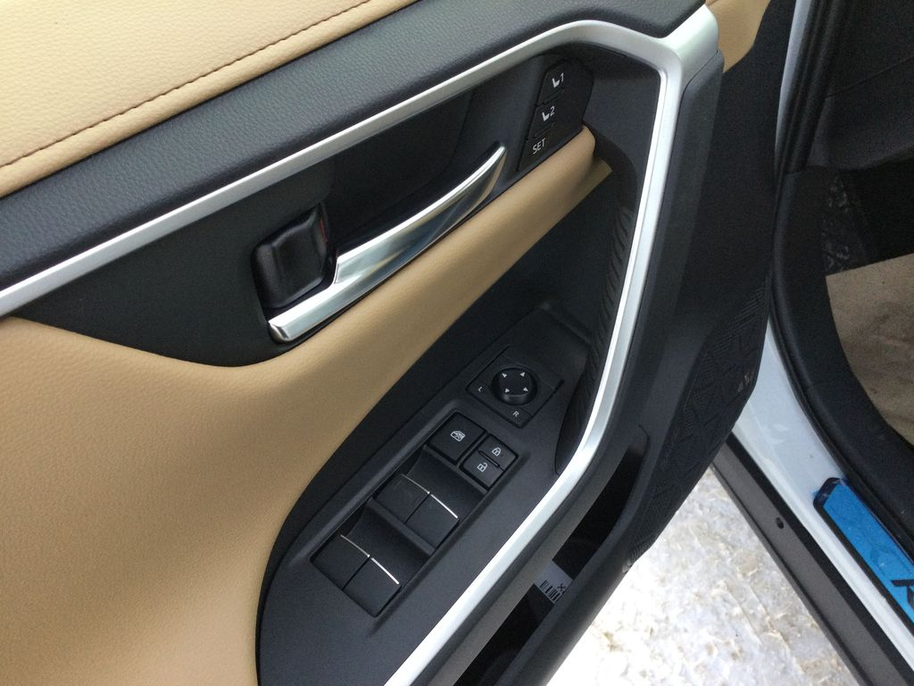 White[Blizzard Pearl] 2021 Toyota RAV4  Driver's Side Door Controls Photo in Brockville ON