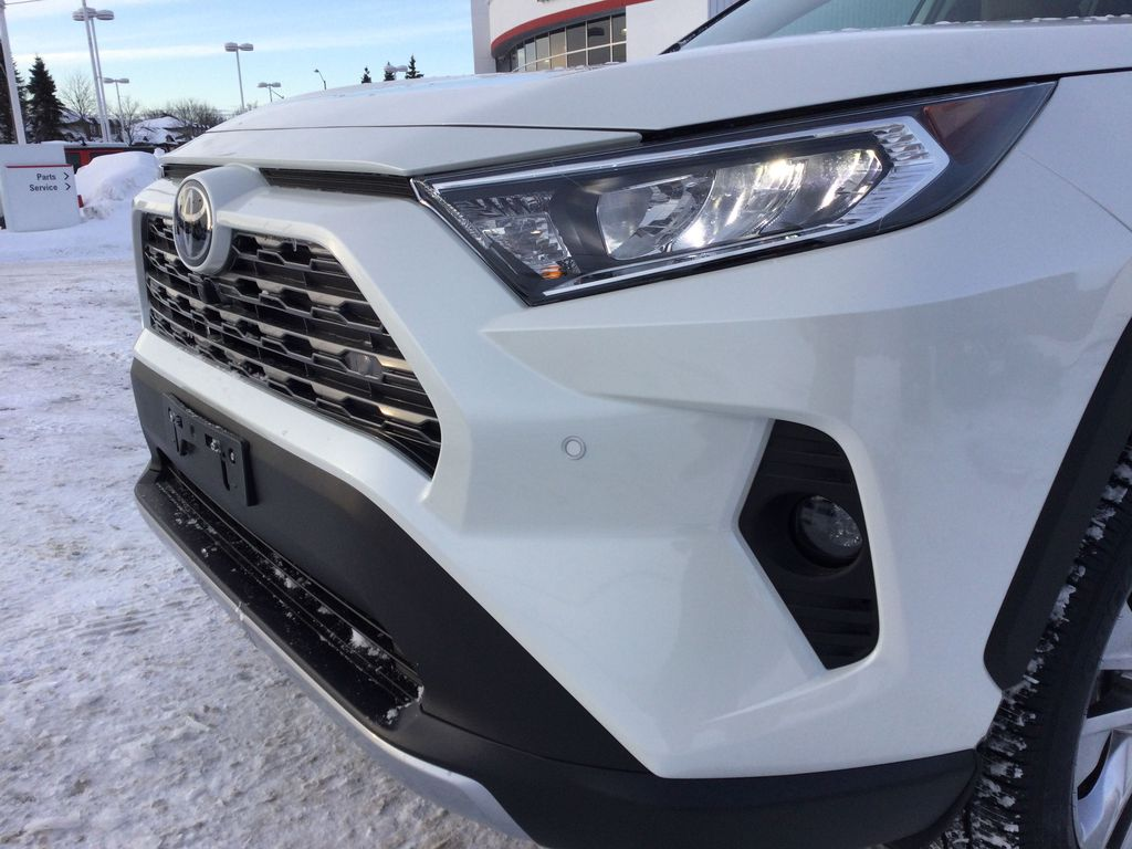 White[Blizzard Pearl] 2021 Toyota RAV4 Left Front Head Light / Bumper and Grill in Brockville ON
