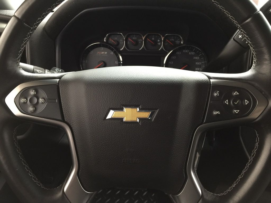 Red[Victory Red] 2015 Chevrolet Silverado 1500 LT Steering Wheel and Dash Photo in Sherwood Park AB