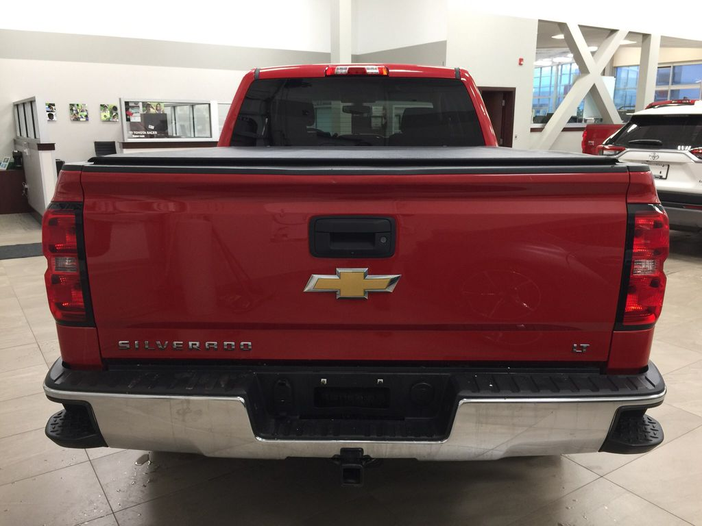 Red[Victory Red] 2015 Chevrolet Silverado 1500 LT Rear of Vehicle Photo in Sherwood Park AB