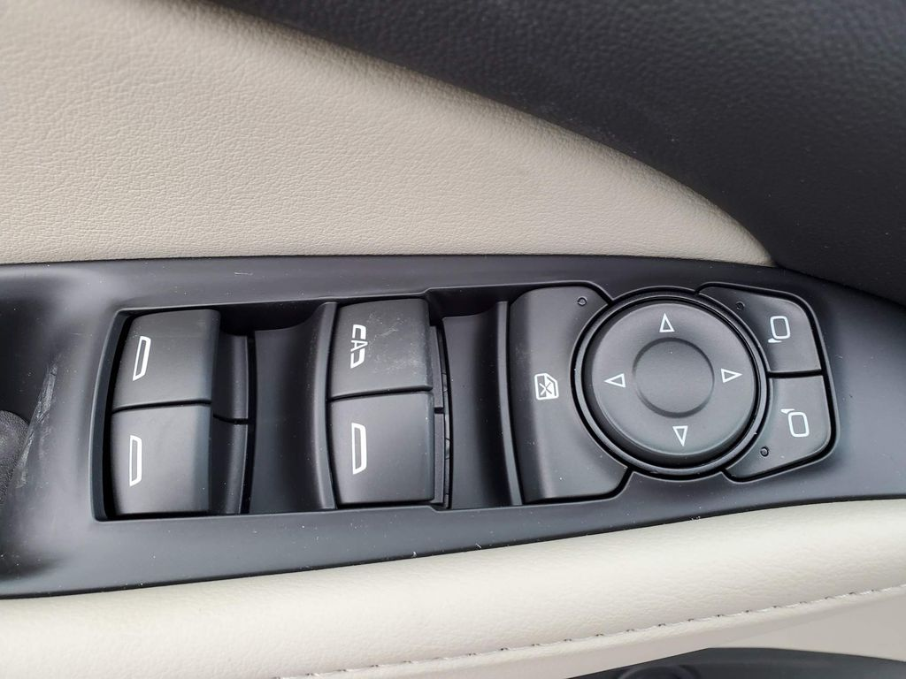 Dark Grey 2021 Buick Enclave Driver's Side Door Controls Photo in Airdrie AB