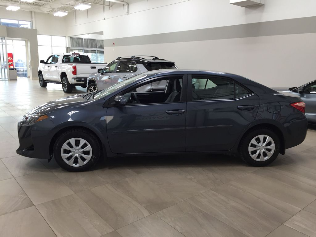 Silver[Classic Silver Metallic] 2019 Toyota Corolla CE Auto Left Side Photo in Sherwood Park AB