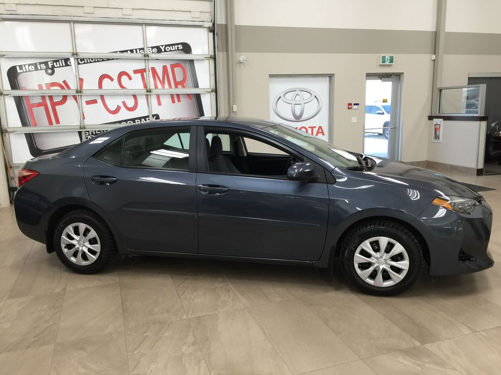 Silver[Classic Silver Metallic] 2019 Toyota Corolla CE Auto Right Side Photo in Sherwood Park AB