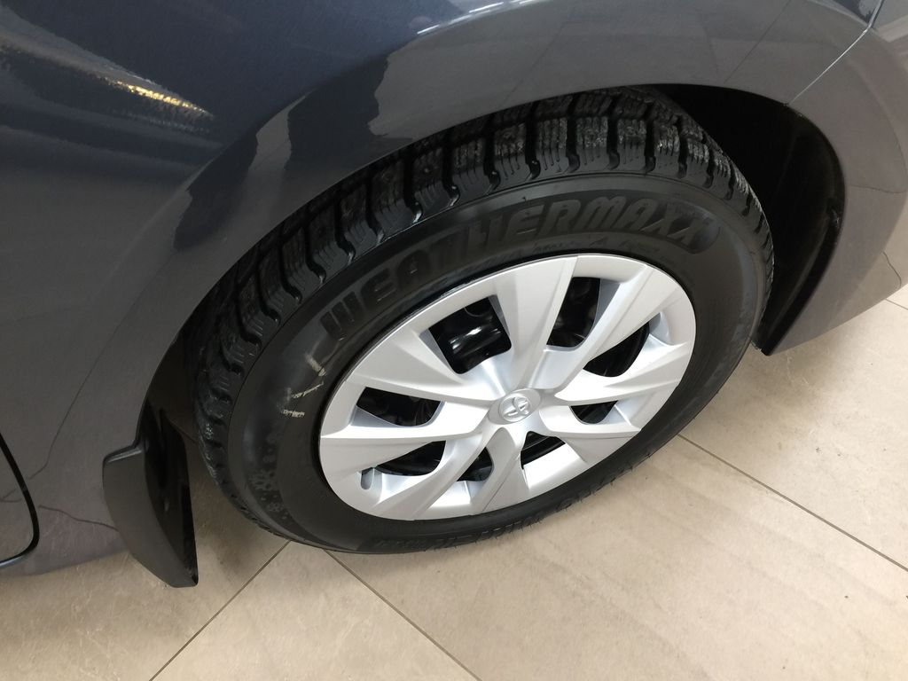 Silver[Classic Silver Metallic] 2019 Toyota Corolla CE Auto Right Front Rim and Tire Photo in Sherwood Park AB