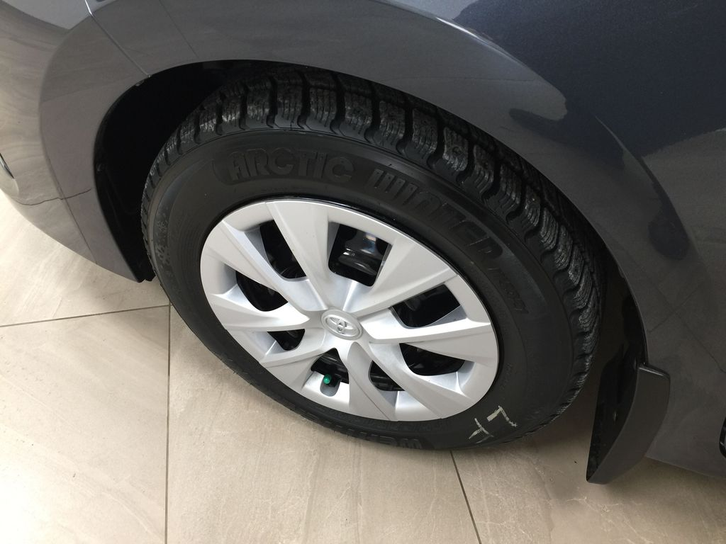 Silver[Classic Silver Metallic] 2019 Toyota Corolla CE Auto Left Front Rim and Tire Photo in Sherwood Park AB