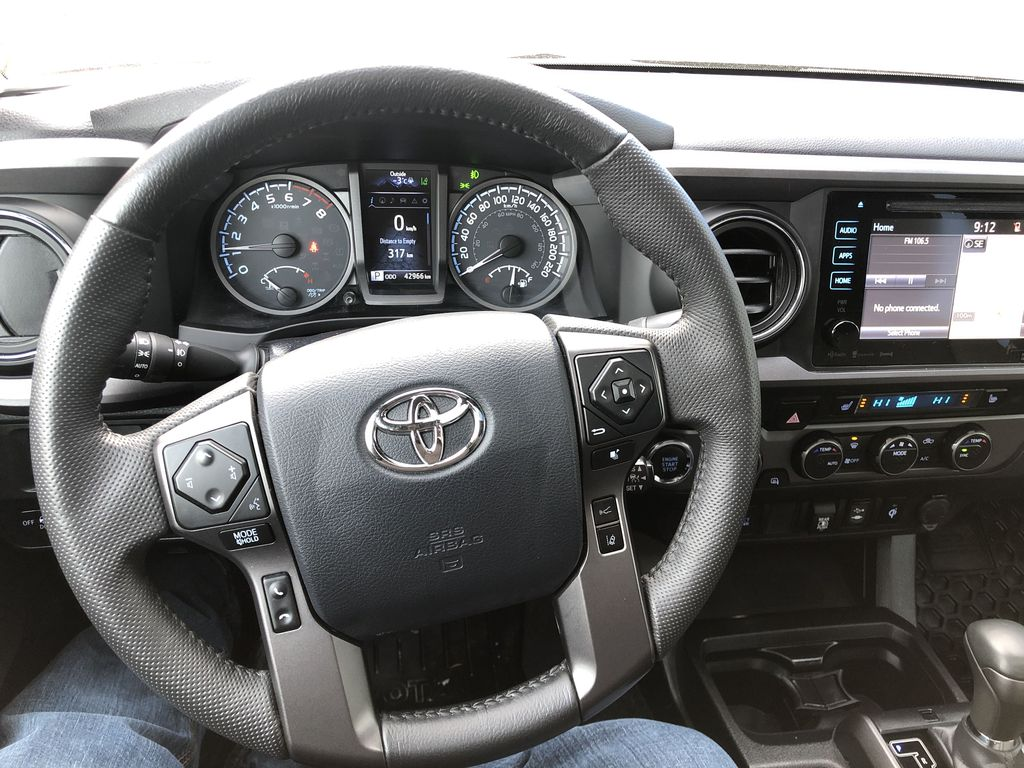 Gray[Cement Grey Metallic] 2019 Toyota Tacoma SR5 Steering Wheel and Dash Photo in Canmore AB