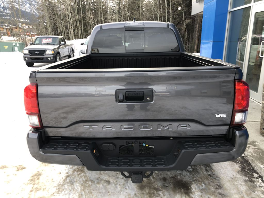 Gray[Cement Grey Metallic] 2019 Toyota Tacoma SR5 Rear of Vehicle Photo in Canmore AB