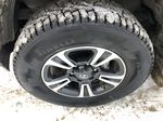 Gray[Cement Grey Metallic] 2019 Toyota Tacoma SR5 Left Front Rim and Tire Photo in Canmore AB