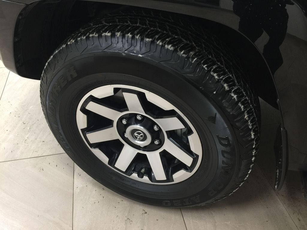 Black[Midnight Black Metallic] 2020 Toyota 4Runner TRD Off-Road Left Front Rim and Tire Photo in Sherwood Park AB