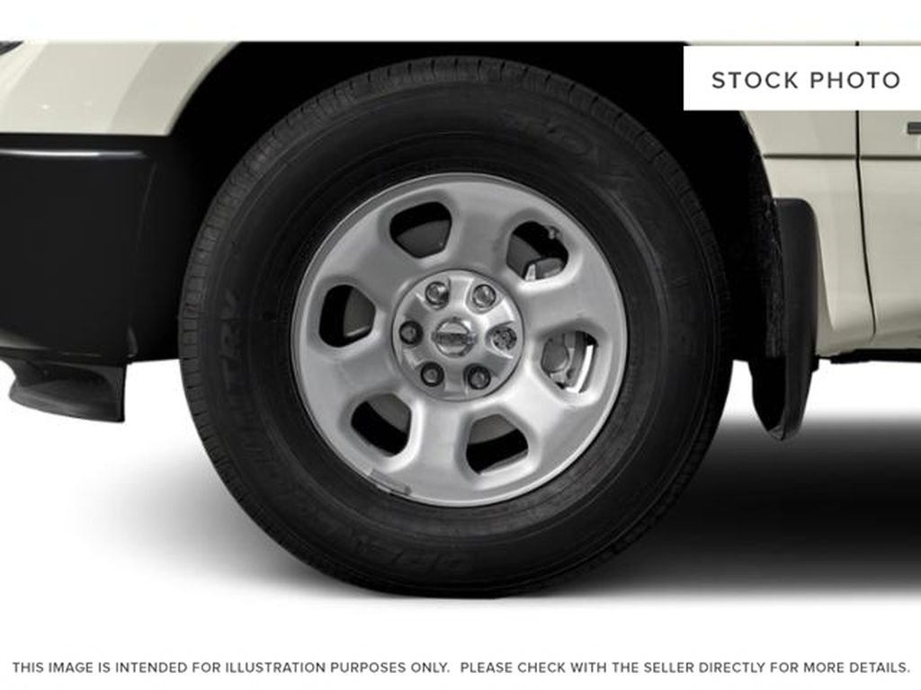 White[Glacier White] 2018 Nissan Titan Left Front Rim and Tire Photo in Fort Macleod AB