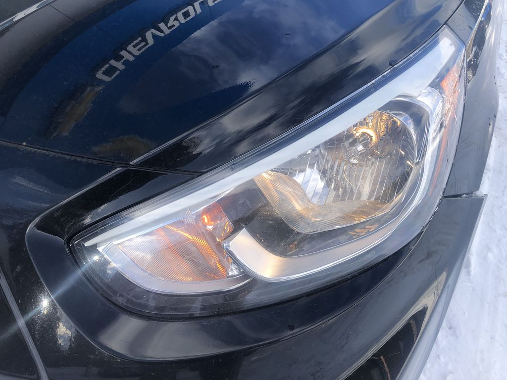 Black[Ultra Black Pearl] 2015 Hyundai Accent Left Front Head Light / Bumper and Grill in Canmore AB