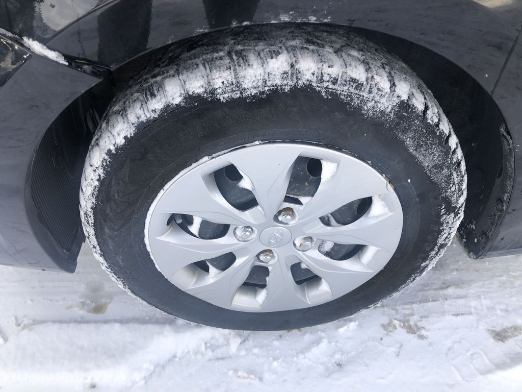 Black[Ultra Black Pearl] 2015 Hyundai Accent Left Front Rim and Tire Photo in Canmore AB