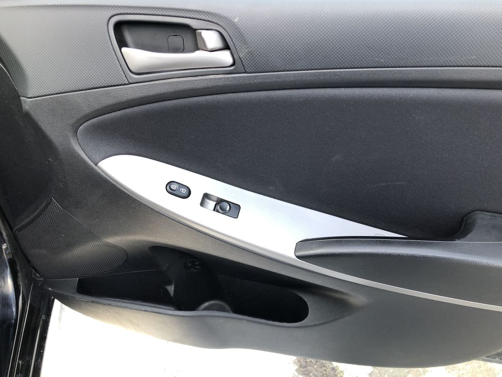 Black[Ultra Black Pearl] 2015 Hyundai Accent Right Front Interior Door Panel Photo in Canmore AB