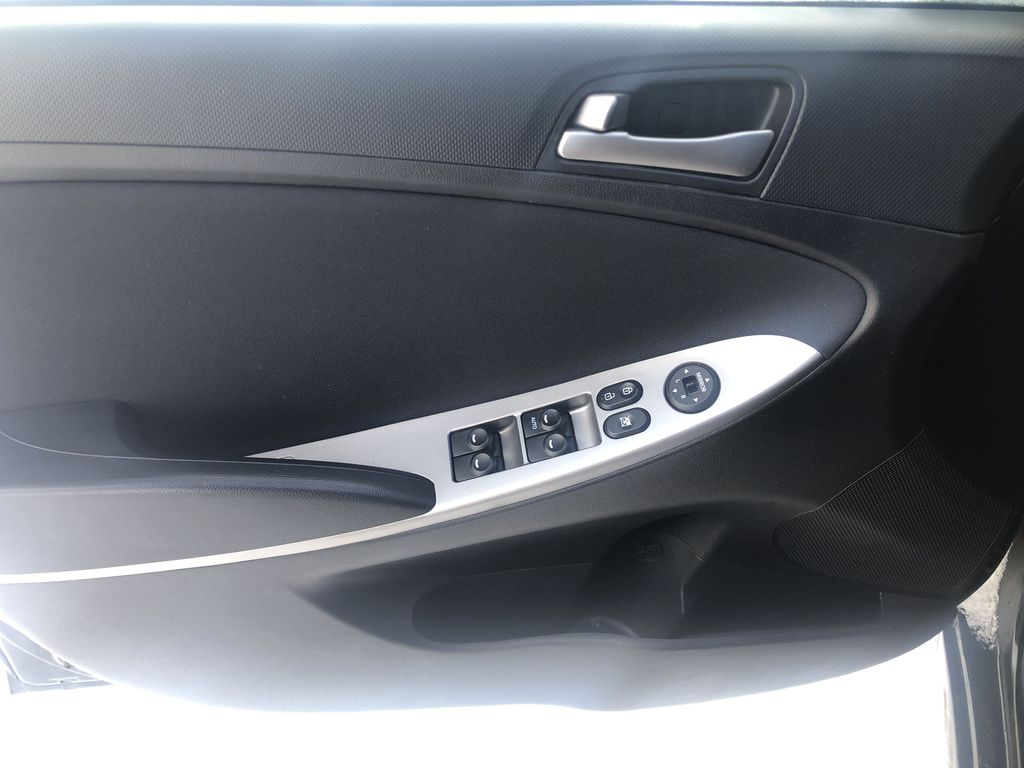 Black[Ultra Black Pearl] 2015 Hyundai Accent Left Front Interior Door Panel Photo in Canmore AB
