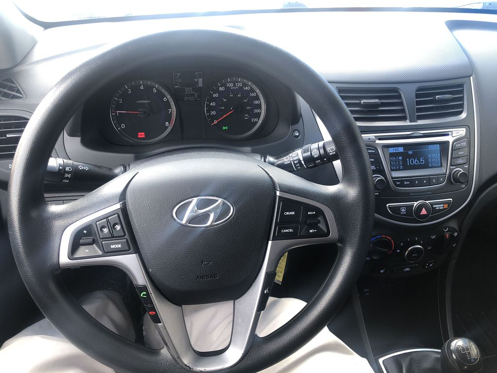 Black[Ultra Black Pearl] 2015 Hyundai Accent Steering Wheel and Dash Photo in Canmore AB