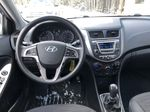 Black[Ultra Black Pearl] 2015 Hyundai Accent Strng Wheel: Frm Rear in Canmore AB