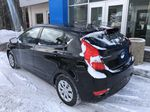 Black[Ultra Black Pearl] 2015 Hyundai Accent Left Rear Corner Photo in Canmore AB