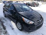 Black[Ultra Black Pearl] 2015 Hyundai Accent Right Front Corner Photo in Canmore AB