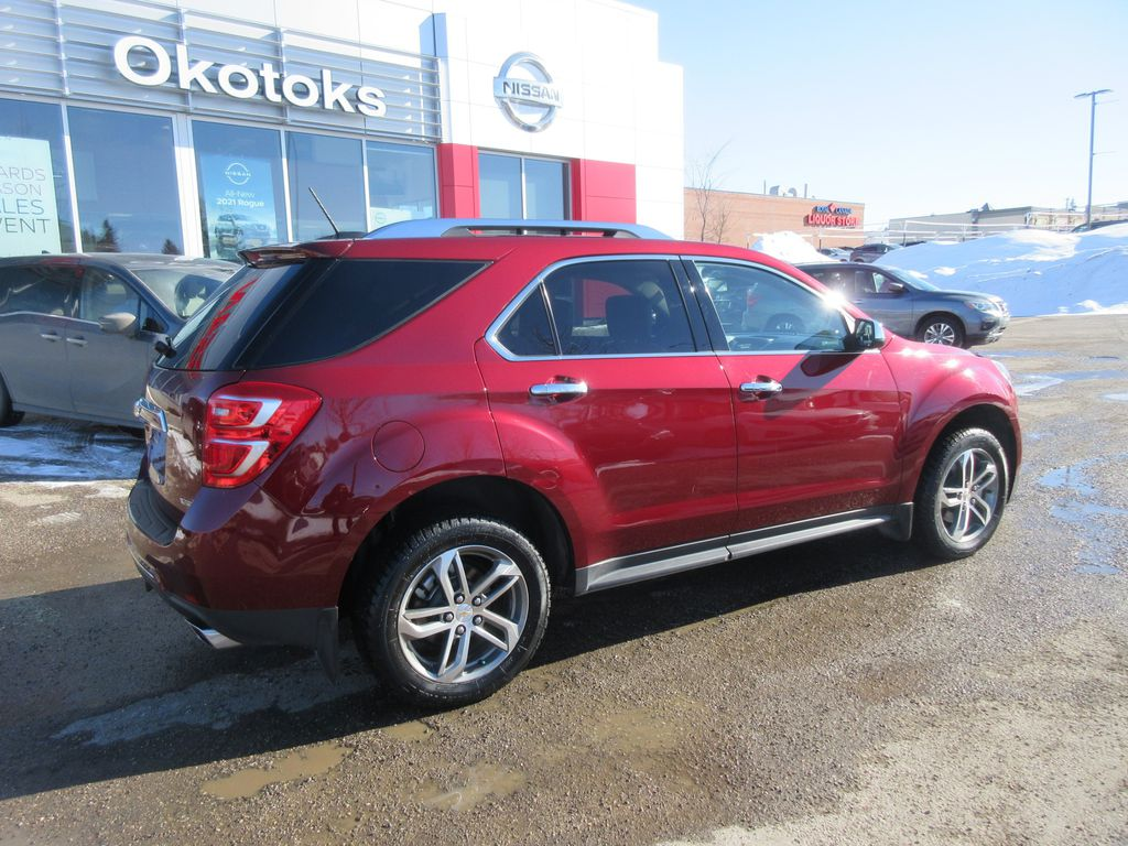 Red[Siren Red Tintcoat] 2017 Chevrolet Equinox Center Console Photo in Okotoks AB