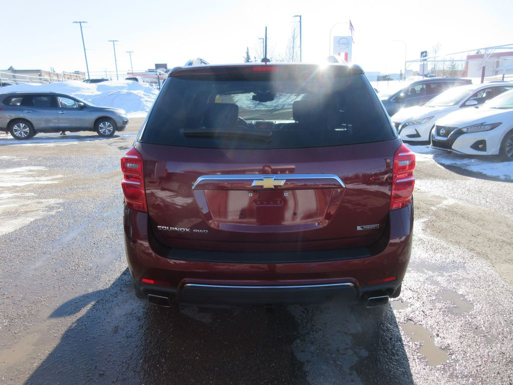 Red[Siren Red Tintcoat] 2017 Chevrolet Equinox Central Dash Options Photo in Okotoks AB