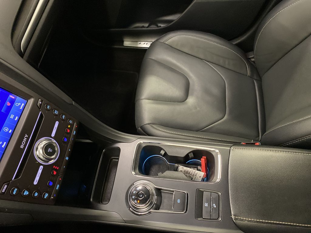 Red[Rapid Red Metallic Tinted Clearcoat] 2020 Ford Fusion Hybrid Center Console Photo in Dartmouth NS