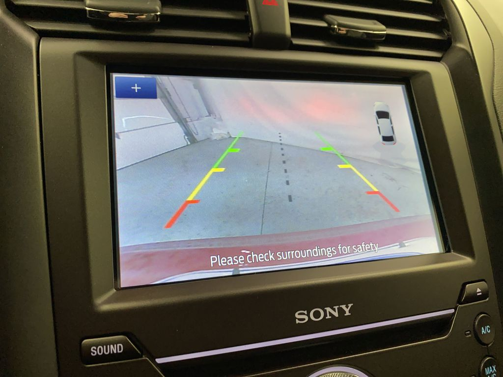 Red[Rapid Red Metallic Tinted Clearcoat] 2020 Ford Fusion Hybrid Backup Camera Closeup Photo in Dartmouth NS