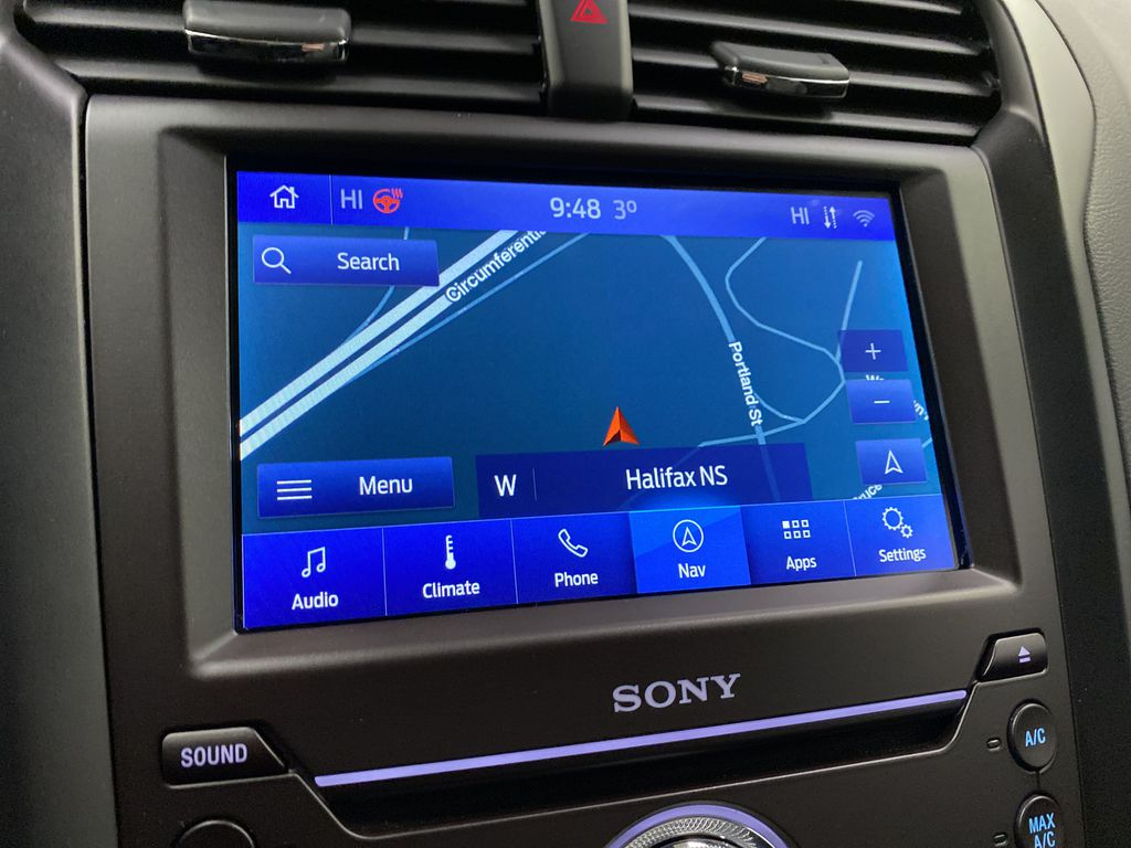 Red[Rapid Red Metallic Tinted Clearcoat] 2020 Ford Fusion Hybrid Navigation Screen Closeup Photo in Dartmouth NS