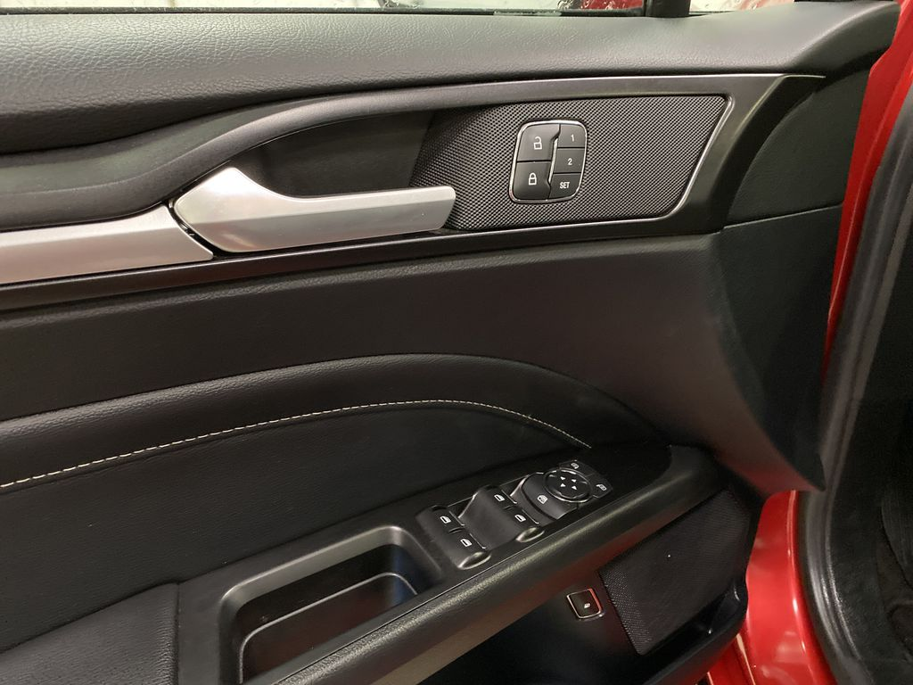 Red[Rapid Red Metallic Tinted Clearcoat] 2020 Ford Fusion Hybrid  Driver's Side Door Controls Photo in Dartmouth NS