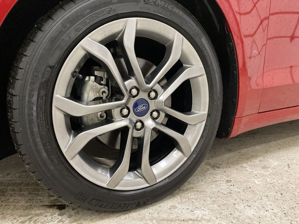 Red[Rapid Red Metallic Tinted Clearcoat] 2020 Ford Fusion Hybrid Left Front Rim and Tire Photo in Dartmouth NS