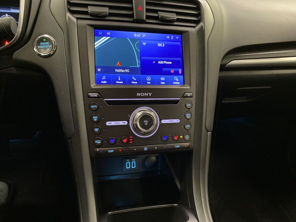 Red[Rapid Red Metallic Tinted Clearcoat] 2020 Ford Fusion Hybrid Central Dash Options Photo in Dartmouth NS