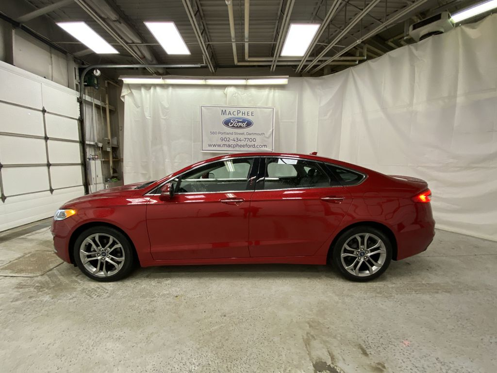 Red[Rapid Red Metallic Tinted Clearcoat] 2020 Ford Fusion Hybrid Left Side Photo in Dartmouth NS
